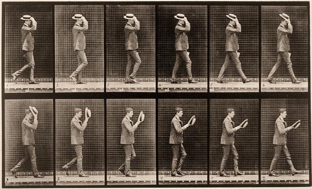 Walking, taking off hat, ca. 1884-1887